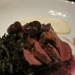 Smoked duck breast with preserved cherries, braised red cabbage, parsley root, black trumpet mushrooms